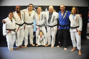 Hart BJJ Black Belt party picture. The little photo bomber is not a BB :)