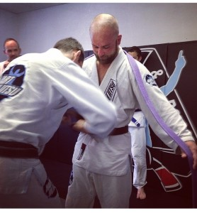 Tom Gilmore receiving his Brown belt from  Coach Hart
